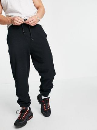 tapered waffle sweatpants in black