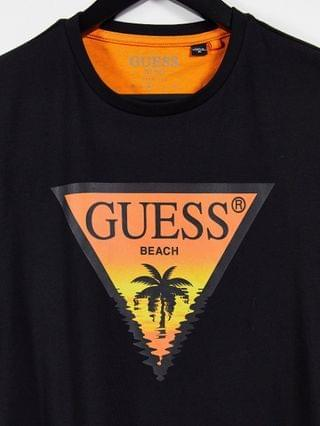 Guess t-shirt in black with chest logo palm tree print