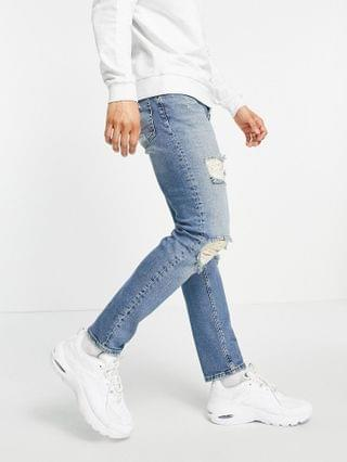 stretch slim jeans in vintage mid wash with heavy rips