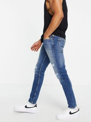 River Island skinny jeans with rip & repair in mid blue