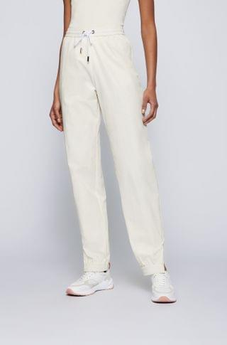 WOMEN Relaxed-fit pants with cuffed zipped hems