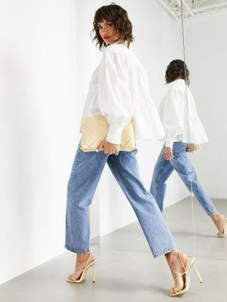 WOMEN EDITION tapered jeans with twisted seam in mid wash