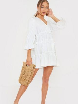 WOMEN In The Style x Billie Faiers wrap over flutter sleeve tiered mini dress in white