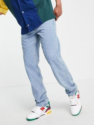 straight leg jeans in mid wash blue with backside rip