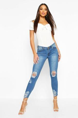 WOMEN Mid Rise Distressed Knee And Ankle Skinny Jeans